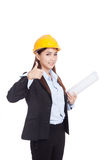Asian engineer woman thumbs up with blueprints Royalty Free Stock Image
