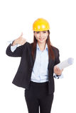 Asian engineer woman thumbs up with blueprints Royalty Free Stock Photo