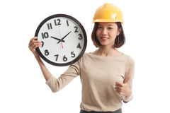 Asian engineer woman thumbs up with a clock Royalty Free Stock Photos