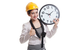 Asian engineer woman thumbs up with a clock. Stock Images