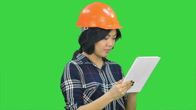 Asian engineer woman using tablet on a Green Screen, Chroma Key stock video footage