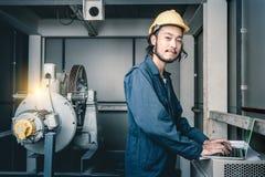 Asian engineers look at blueprint royalty free stock photos