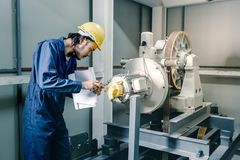 Asian engineers standing and smile to camera royalty free stock photo