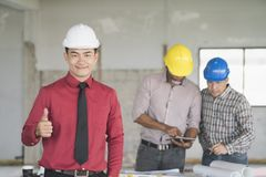 Asian engineers were consulted together and plan in construction Royalty Free Stock Image