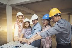 Asian engineers were consulted together and trust in team giving Royalty Free Stock Photo