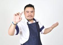 Asian entrepreneur fat man touching an imaginary button virtual screen standing Royalty Free Stock Photo