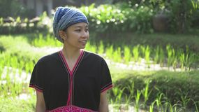 Asian ethnic woman with native dress smile at her organic rice fi royalty free stock images