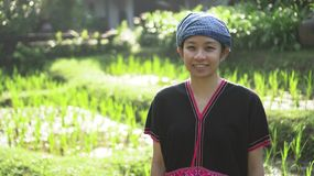 Asian ethnic woman with native dress smile at her organic rice fi stock images