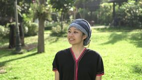 Asian ethnic woman with native dress smile at her organic rice fi stock photo