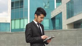 Asian ethnic businessman working on tablet stock video footage