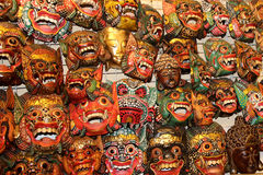 Asian ethnic souvenir masks hanging on the wall Royalty Free Stock Photography