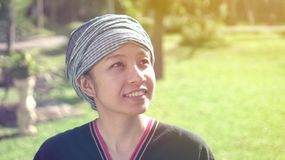 Asian ethnic woman with native dress smile at her organic rice fi stock photography