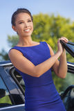 Asian Eurasian Woman Business Woman By Her Car Royalty Free Stock Image