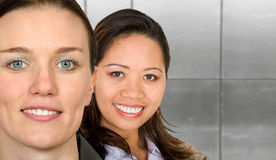 Asian-european female partnership Royalty Free Stock Photos