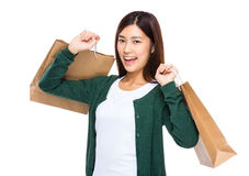 Asian excited woman hold shopping bag Royalty Free Stock Image