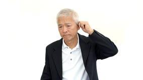 Asian executive senior business man wearing suit and do upset ge Royalty Free Stock Photos