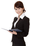 Asian executive woman. Smiling and looking at you holding book, half length closeup portrait on white background Stock Image