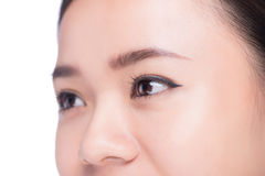 Asian eye woman eyebrow eyes lashes over white. Royalty Free Stock Photo