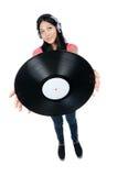 Asian fêmea DJ que prende um registro para fora Fotografia de Stock Royalty Free