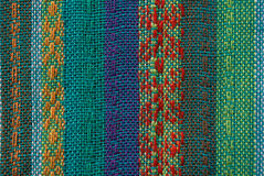 Asian fabric texture. Colorful asian fabric texture with visible thread Royalty Free Stock Images