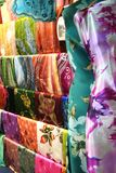 Asian fabrics. Traditional asian fabrics and clothes for sale in a shop in Malaysia Royalty Free Stock Photos