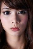 Asian face. A beautiful asian girl face close up Royalty Free Stock Photos