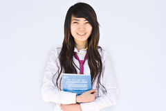 Asian famale student. Smiling student carrying bag and books outdoors Royalty Free Stock Images