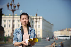 Asian famale tourist with guide book in city Stock Images