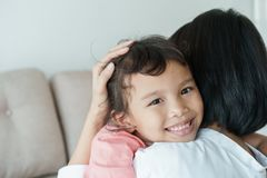 Asian families with daughters and mothers are embracing each other with love. Asian girl with a smile on her face is in the mother. `s arms. Family with mother stock images