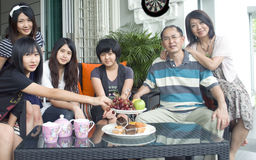 Asian family. Having tea time together royalty free stock photo