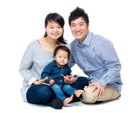 Asian family with baby daughter. On white Royalty Free Stock Photos