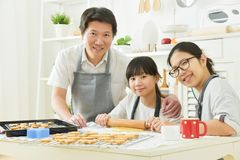 Asian family baking cookies. Royalty Free Stock Photo