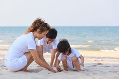 Asian family on beach Stock Photo