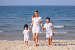 Asian family on beach Stock Images