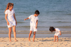 Asian family on beach Royalty Free Stock Photos