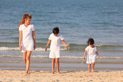 Asian family on beach Royalty Free Stock Images