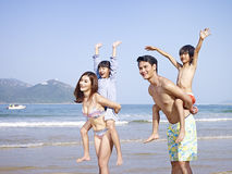 Asian family on beach royalty free stock image