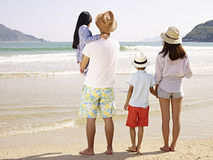 Asian family on beach Stock Image