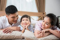 Asian family on a bed, father Stock Photo