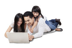 Asian family browsing internet online Royalty Free Stock Image