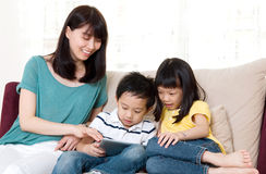 Asian family. Browsing internet on tablet computer Stock Photo