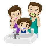 Asian Family Brushing their Teeth Stock Photo