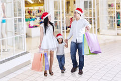 Asian family carrying shopping bags at mall Stock Photos