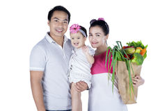 Asian family carrying vegetables Stock Photo