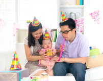 Asian family celebrating baby birthday party Royalty Free Stock Image