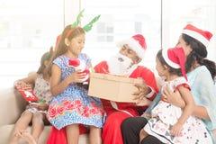Asian family celebrating Christmas holiday stock images