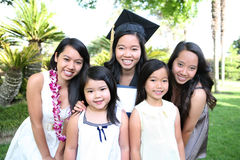 Asian Family Celebrating Graduation. An asian family of girls and sisters celebrating a college graduation Stock Image