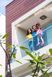 Asian family with child standing on home balcony Royalty Free Stock Image