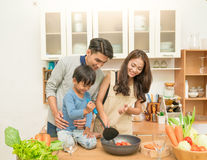 Asian family cooking Stock Images