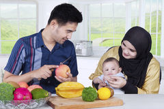 Asian Family Cooking Together Royalty Free Stock Images